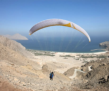 Paragliding into Zighy Bay