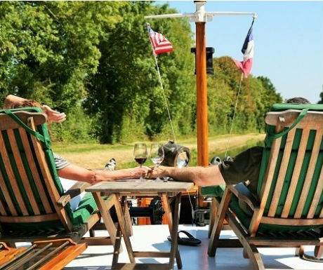 luxury boat journey Burgundy relaxing onboard