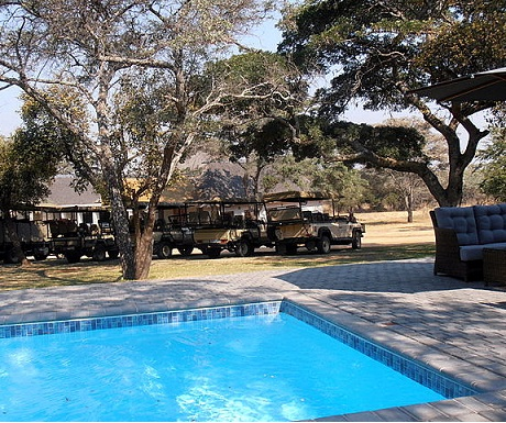 Lovely pool and furious observation landrovers during Monate Game Lodge